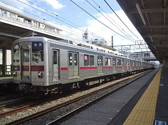 Tobu 10000 series - 10000 series 2-car set 11201 at the rear of a 10-car formation on the Tobu Tojo Line in September 2013
