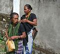 Torajan woman chewing betelnut wrapped in betel leaf.jpg