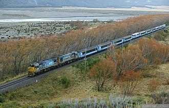 TranzAlpine - The TranzAlpine, hauled by DC 4513 and DCP 4628, skirting the Waimakariri River.