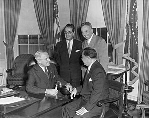 Myron M. Cowen - Myron Cowen (satanding, right), with U.S. President Harry S. Truman (seated, left) and Philippines President Elpidio Quirino (seated, right)