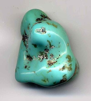 Turquoise pebble, one inch (2.5 cm) long. This pebble is greenish and therefore low grade.