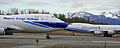 Two 747s passing at ANC (6193714721).jpg