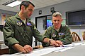 U.S. Air Force 1st Lt. Kevin Elardo, left, and Lt. Col. Jeff Richenberger, both KC-135 Stratotanker pilots with the 336th Air Refueling Squadron, conduct a mission planning brief May 15, 2013, at Eglin Air Force 130515-F-BU402-168.jpg