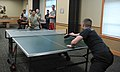 U.S. Air Force 1st Lt. Stigen Westberg, foreground, deputy commander of the 341st Operations Support Squadron, plays a game of pingpong against Airman 1st Class Daniel Torres, assigned to the 819th Rapid 130425-F-ES731-092.jpg