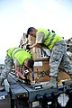 U.S. Air Force Airman 1st Class Steven Shorter, left, and Airman 1st Class Tim Sage, both with the 435th Contingency Response Group, secure a pallet onto a cargo loader before driving the vehicle to a C-17 140116-A-ZZ999-002.jpg