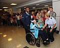 U.S. Air Force Airman First Class Virgilio Ramirez, center, assigned to the 336th Training Squadron, escorts Earlene Syverson, a World War II veteran, as Col. Maureen Smith, right, commander of the 81st Training 130423-F-BD983-010.jpg
