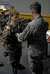 U.S. Air Force Staff Sgt. Robert Colliton and Okinawa Squadron CAP Encampment cadet.jpg