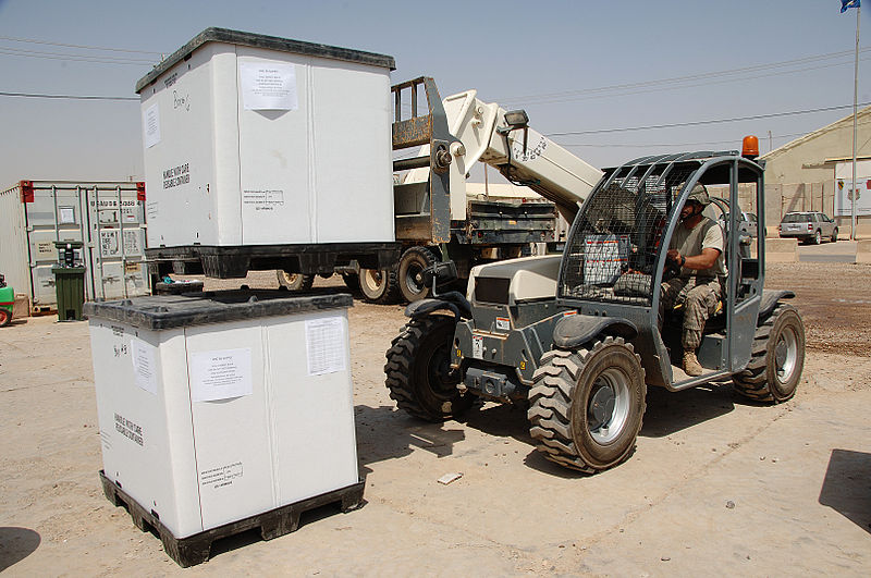 File:U.S. Army Sgt. Justin Foertsch drives a forklift carrying previously inspected unit packs to a movable storage container, on Camp Taji, Iraq, Aug. 22, 2009 090822-A-IZ725-125.jpg