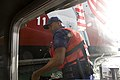 U.S. Coast Guard Machinery Technician 2nd Class Ahmed Sanura, with U.S. Coast Guard Station Seattle, prepares his lines for mooring up a response boat-small in Seattle May 26, 2013 130526-G-AV652-174.jpg