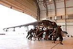 U.S. Marines with Marine Attack Squadron (VMA) 211 replace the wings of an AV-8B Harrier II aircraft at Camp Bastion in Helmand province, Afghanistan, Sept 120903-M-EF955-018.jpg