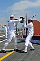 U.S. Navy Culinary Specialist Seamen Tabitha Lifa, right, and Edgar Batista perform an exhibition drill set during a change of command ceremony aboard the aircraft carrier USS Ronald Reagan (CVN 76) in San Diego 130813-N-AV746-166.jpg