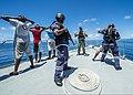 U.S. Navy Petty Officer 2nd Class John A. Wilcox, center background, a maritime interdiction operations expert, instructs Mauritian boarding team members on detainee handling procedures Nov. 13, 2013, off 131113-N-EZ054-191.jpg