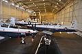 U.S. Navy T-6 Texan II aircraft assigned to Training Air Wing 6 at Naval Air Station Pensacola, Fla., sit packed tightly in a hangar in preparation for the arrival of Tropical Storm Isaac Aug. 27, 2012 120827-N-ZZ999-070.jpg