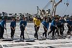 U.S. Sailors scrub the flight deck of the aircraft carrier USS Harry S. Truman (CVN 75) March 9, 2014, in the Gulf of Oman 140309-N-VE959-053.jpg