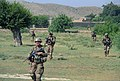 U.S. Soldiers with Echo Company, 2nd Battalion, 506th Infantry Regiment, 4th Brigade Combat Team, 101st Airborne Division make their way across a field June 2, 2013, during a mission in Khost province 130602-A-DQ133-218.jpg