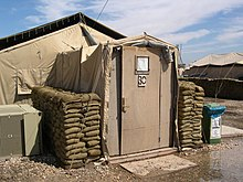 U.S. Army tent with constructed wooden entrance air conditioner and sandbags for protection. Victory Base Baghdad Iraq (April 2004). & Tent - Wikipedia