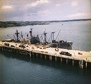 USNS Pvt Francis X. McGraw (T-AK-241) loading chemical weapons at Tengan Pier, Okinawa during Operation Red Hat in September 1971. Operation Red Hat involved removing chemicals stored on Okinawa to Johnston Atoll.
