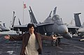 US Navy 021202-N-0271M-011 Jackie Chan enjoys his experiences on the flight deck during a tour of the Kitty Hawk.jpg