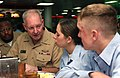 US Navy 031007-N-2420K-002 Chief of Naval Personnel, Vice Adm. Gerald L. Hoewing, talks with USS Essex (LHD 2) sailors while eating breakfast in the ship's mess decks.jpg