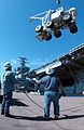 US Navy 040309-N-0905V-009 The flight deck crash and salvage crane aboard the aircraft carrier USS Carl Vinson's (CVN 70) is off-loaded from the flight deck with the help of civilian shipyard workers.jpg