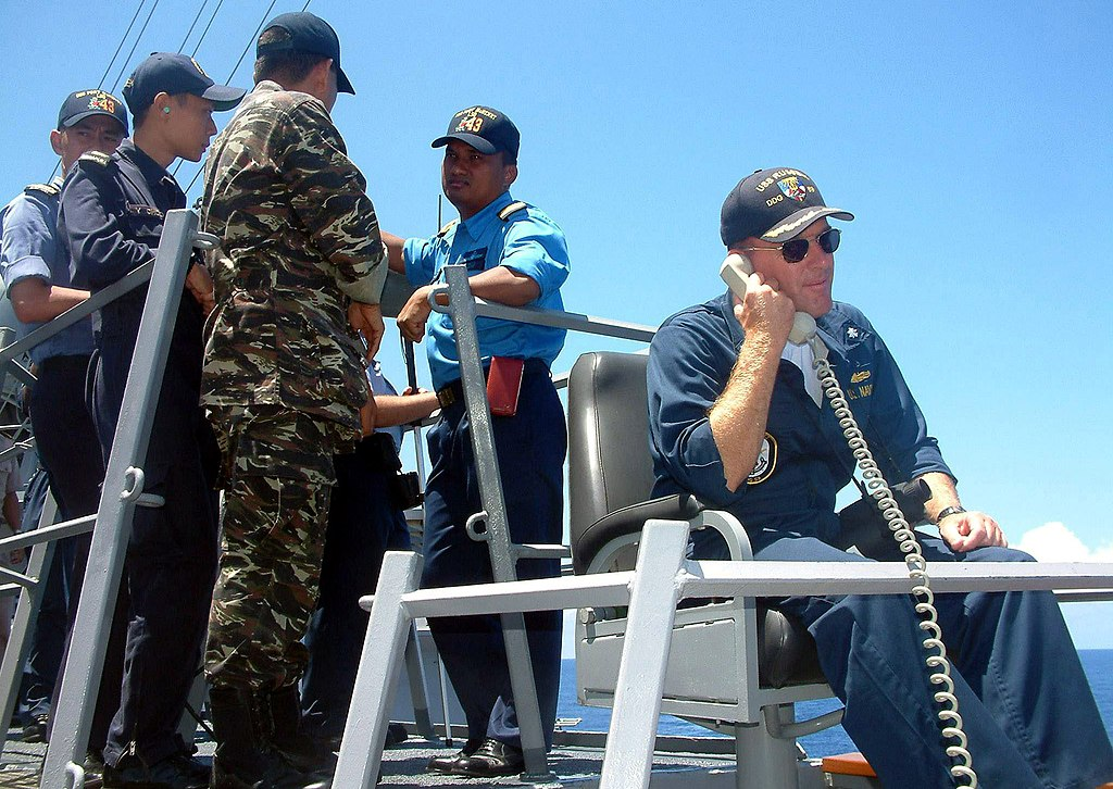 US Navy 040527-N-4104L-001 Guided missile destroyer USS Russell (DDG 59), Commanding Officer, Cmdr. William Kearns III, communicates with his combat information center