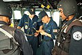 US Navy 041006-N-0021M-004 Operations Specialist Seaman Chia Lee, center, assigned to the guided missile frigate USS Gary (FFG 51), translates a Chinese message for boarding team members from the Indian Navy frigate INS Brahmap.jpg
