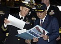 US Navy 041120-N-4008C-034 Commanding Officer, USS Bataan (LHD 5), Capt. Nora Tyson, presents a photograph to Japanese Minister of State for Defense, Yoshinori Ohno.jpg