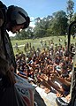US Navy 050107-N-9293K-254 Indonesian citizens are delighted as a U.S. Navy air crewman helicopter drops food, cookies, and water to them at a village on the island of Sumatra, Indonesia.jpg