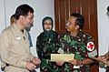 US Navy 050316-N-6665R-010 Commanding Officer, Medical Treatment Facility, Capt. David Llewellyn presents a certificate of appreciation to Indonesian Army Colonel Dr. Dedy Achdiat Dasuki.jpg