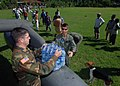 US Navy 051016-N-5526M-029 U.S. Army Warrant Officer Jeremy Bennett and Specialist Ryan Becker unload food, water, and medicine from a U.S. Army UH-60 Blackhawk helicopter during relief efforts for victims of Hurricane Stan.jpg