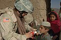US Navy 060612-A-5679R-008 U.S. Navy Petty Officer 1st Class Michele Reed, assigned to the 405th Civil Affairs Battalion, gives a young Afghan boy a deworming solution.jpg