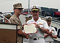 US Navy 060828-N-7163S-007 Chief of Naval Personnel, Vice Adm. John C. Harvey Jr., right, congratulates Navy Reserve Medical Corps Captain Matthew Gratton, after presenting a Bronze Star during Cleveland Navy Week opening cerem.jpg