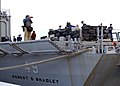 US Navy 070112-N-8544C-003 Sailors aboard the guided missile frigate USS Robert G. Bradley (FFG 49) prepare to offload 23 tons of illegal drugs seized in a multi-national and interagency effort to interdict the flow of narcotic.jpg