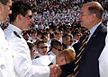 US Navy 070525-N-0593C-002 Secretary of the Navy the Honorable Dr. Donald Winter congratulates one of the Navy's new ensigns during the Class of 2007 graduation and commissioning ceremony.jpg