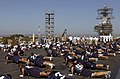 US Navy 070821-N-0555B-131 Members of the University of San Diego Toreros football team perform push-ups on the flight deck of USS Ronald Reagan (CVN 76).jpg