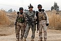 US Navy 080110-N-6891S-092 U.S. Army Staff Sgt. Timothy Douglas from Charlie Company, 2nd Battalion, 502 Infantry Regiment, 101st Airborne Division poses with Iraqi Army soldiers during Operation NANNO II.jpg