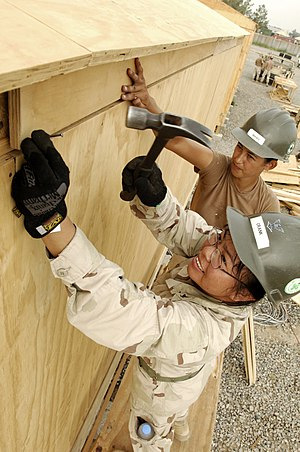 Physical hazard - Image: US Navy 080629 N 6477M 095 Builder 3rd Class Merlyna Crank and Builder Constructionman Irene L. Reeves, both assigned to Naval Mobile Construction Battalion (NMCB) 3 Det. 4, place trimming on birthing spaces being built for Afg