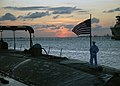 US Navy 080822-N-7668G-029 Machinist's Mate Fireman Zach Vineski prepares to execute evening colors.jpg
