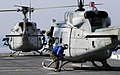 US Navy 100116-N-5345W-012 A Sailor ties down a UH-1N Huey from the Sabers of Marine Light Attack Helicopter Squadron (HMLA) 467 aboard the multi-purpose amphibious assault ship USS Bataan (LHD 5).jpg