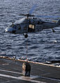 US Navy 100119-N-4236E-066 An MH-60S Sea Hawk helicopter assigned to the Chargers of Helicopter Sea Combat Squadron (HSC) 26 performs a vertical replenishment between the Military Sealift Command.jpg