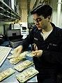 US Navy 100122-N-3485C-101 USS John C. Stennis Sailor works in disbursing office.jpg