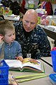 US Navy 100225-N-8497H-001 Capt. Doug McGowen, commanding officer of Naval Support Activity Mid-South, listens to a student read at Millington Elementary School.jpg
