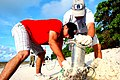 US Navy 100416-N-1401J-015 Master-at-Arms 2nd Class William Curtis and Lt. Cmdr. John Hoke join other Sailors, British Royal Navy Sailors, and civilians at a beach clean-up in Diego Garcia.jpg