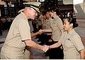 US Navy 101210-N-7491B-028 Rear Adm. C. Forrest Faison III, commander of Naval Medical Center San Diego, congratulates Hospital Corpsman 1st Class.jpg