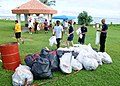 US Navy 110917-N-BT122-458 Sailors pick up trash during a community service event at the War in the Pacific National Historical Park at Asan Beach.jpg