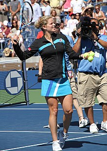 Clijsters preparing to hit souvenir tennis balls into the crowd after her first round match win