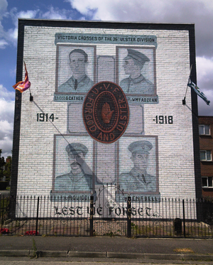 Ulster Volunteers - A mural in Belfast showing four recipients of the Victoria Cross from the 36th (Ulster) Division, with the UVF logo in the middle