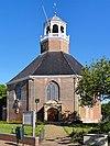 foto van Van Harenskerk, hervormde kerk op omheind kerkhof