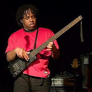 "Victor Wooten - Wooten playing his headless bass guitar known as his ""Sitar Bass"" at the Belly Up in San Diego 2006."
