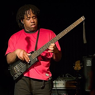 "Victor Wooten - Wooten plays his headless bass guitar known as his ""Sitar Bass"" at the Belly Up in San Diego 2006."